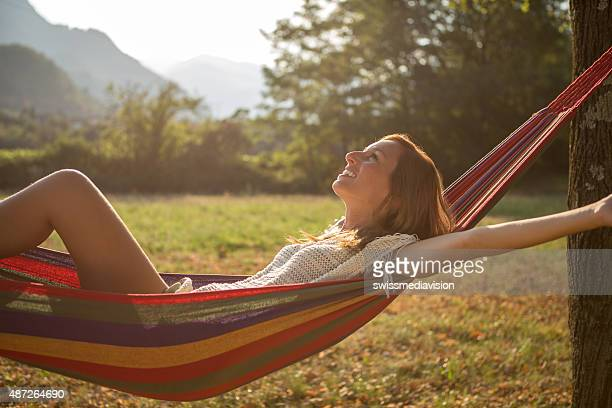 Beauty in nature, woman relaxing on hammock