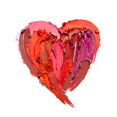 Creative concept photo of cosmetics swatches in the shape of heart love  on white background.