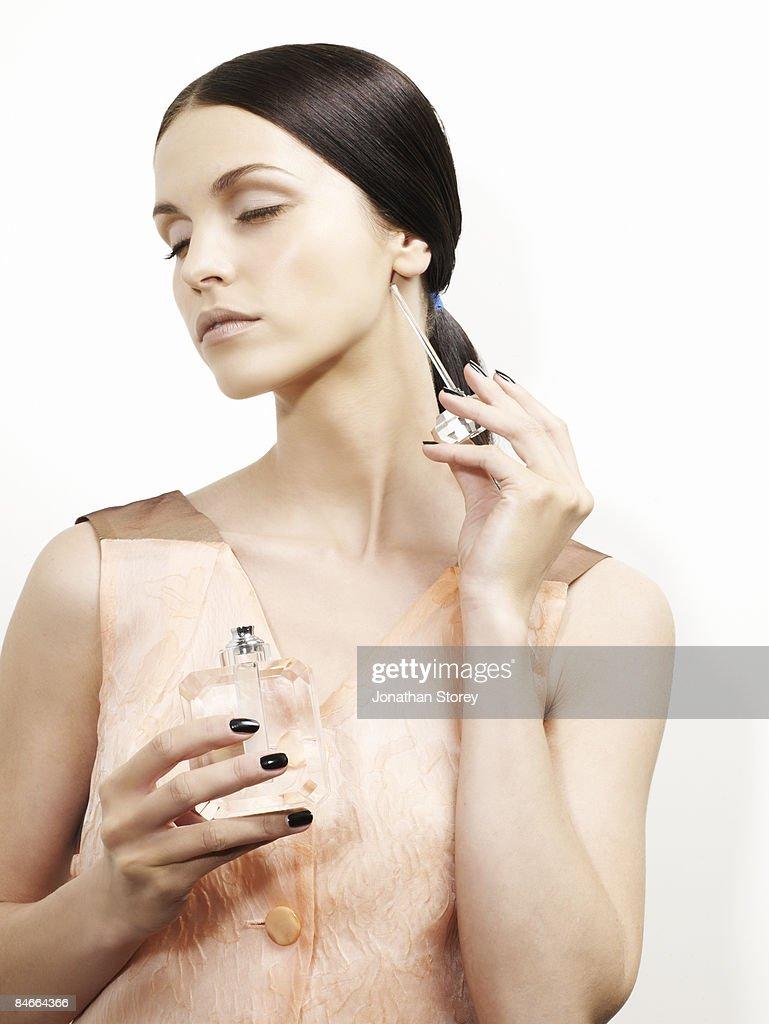 beauty perfume wand side of neck
