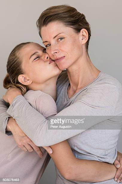 beauty picture of mother and daughter in studio