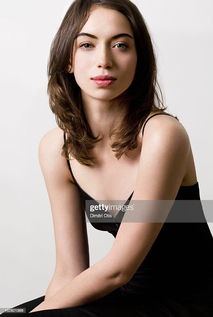 Beauty portrait for brunette woman seated : Stock Photo