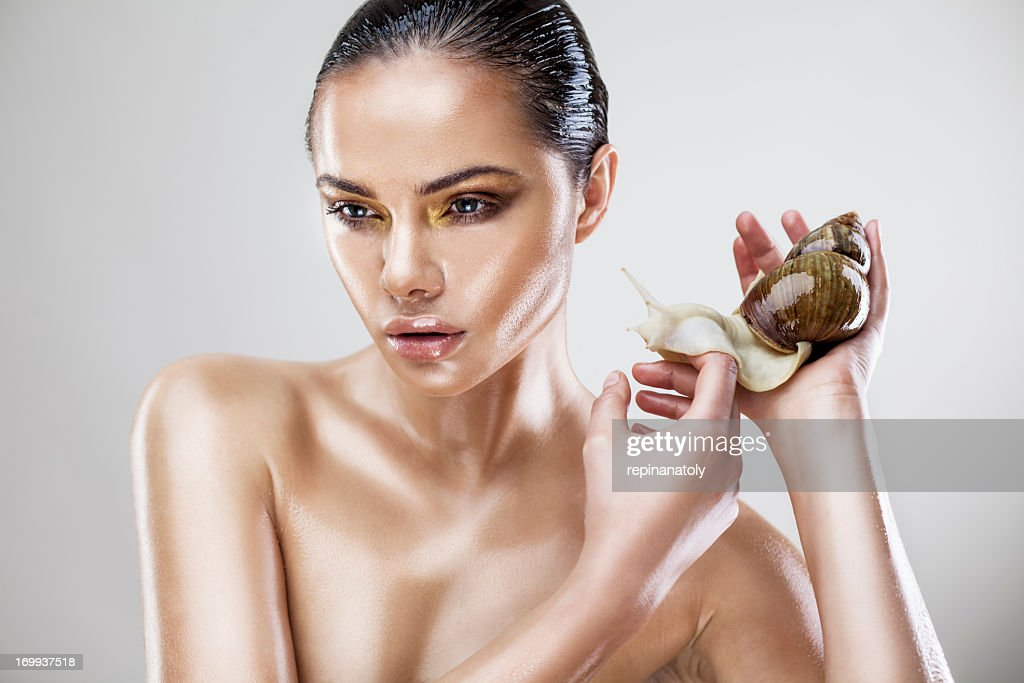 Beauty portrait of a young woman with snail