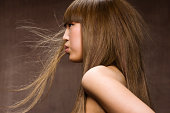 Asian woman with blowing hair