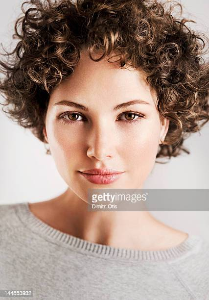 Beauty portrait of curly brunette woman