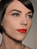 Beauty portrait of female with glossy red lips and glowing skin