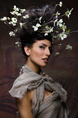 Beautiful woman with flowering twigs in hair