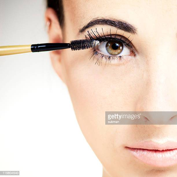 Beauty portrait of woman getting makeup