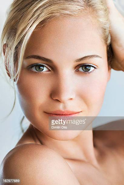 Beauty portrait of young blond woman, close-up