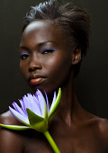 Afro-American woman with purple lotus flower
