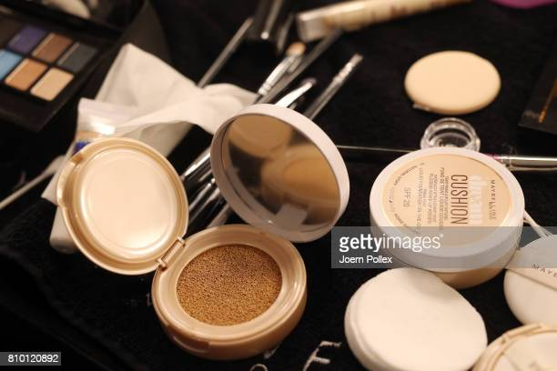 Beauty products are displayed backstage ahead of the Vladimir Karaleev show during the MercedesBenz Fashion Week Berlin Spring/Summer 2018 at...