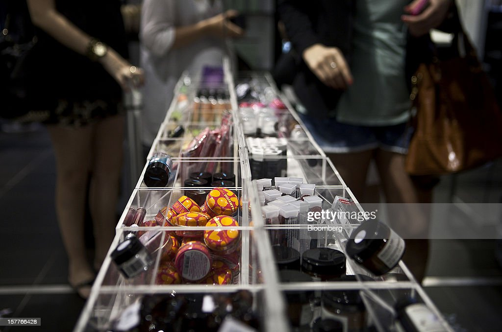 Beauty products are displayed for sale as customers wait in line to check out during the opening of a Sephora SA store at the Riosul shopping mall in Rio de Janeiro, Brazil, on Wednesday, Dec. 5, 2012. Sephora SA, a French beauty product retail chain, opened its first Brazil location earlier this year in July. Photographer: Dado Galdieri/Bloomberg via Getty Images