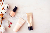 Woman beauty products flatlay on white marble background. Minimal style, blogging concept. Copy space