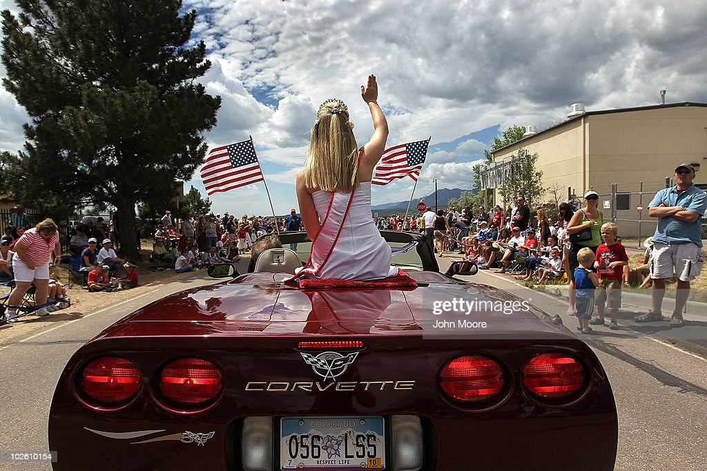 A beauty queen waves during an Independence Day parade on July 3, 2010 in Monument, Colorado. The parade, held a day before the U.S. Independence Day, draws thousands of spectators from throughout central Colorado.
