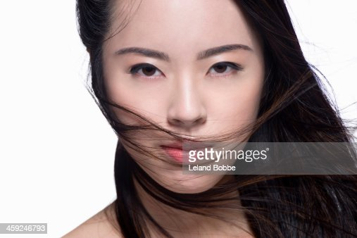 Beauty shot of Asian woman with blowing hair