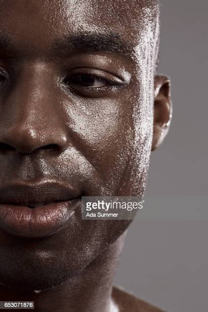 beauty shot of man with water pearls on his skin