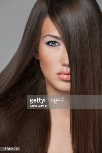 Beauty Shot of Young Woman on Gray Background