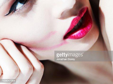 beauty smudged  pink lip stick.