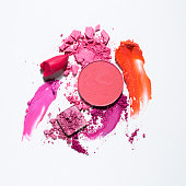 Creative concept photo of cosmetics swatches on white background.