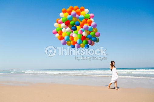 Beauty walking with ballons : Stock Photo