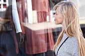 Beautiful young woman window shopping