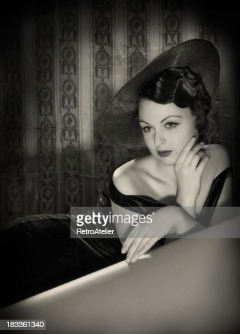 Beauty with hat in film noir style.