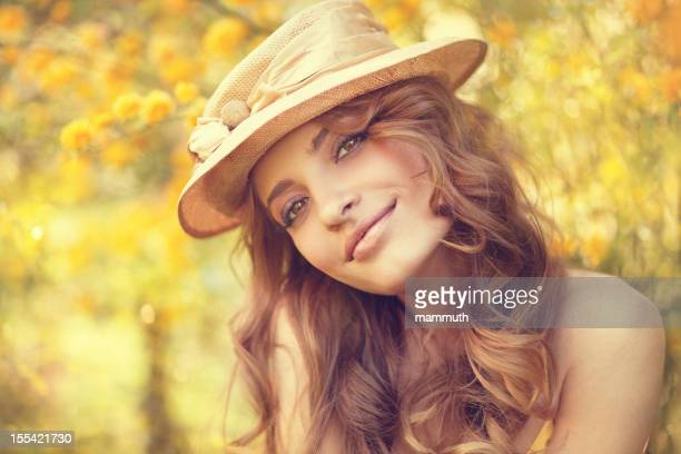 beauty with hat in the nature