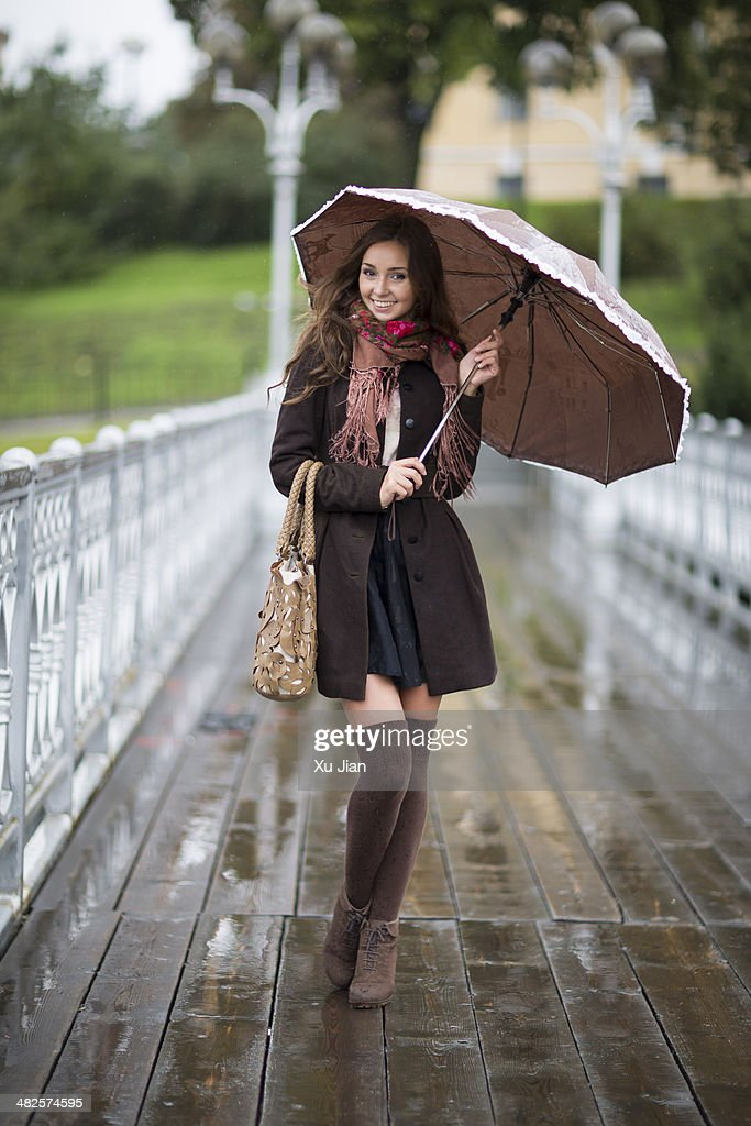 Beauty with umbrella in the rain