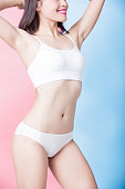 beauty woman body on the blue and pink background