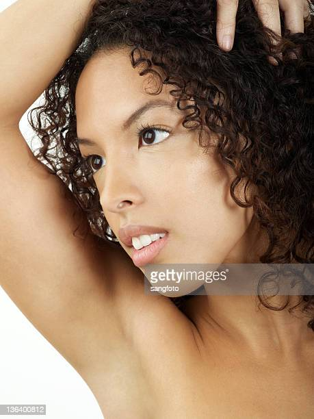 Beauty woman portrait with hand in hair
