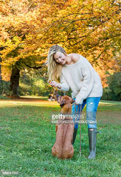 beauty woman with her dog in a park