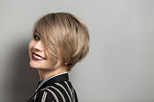 fashion beautiful young woman with short hair over gray background