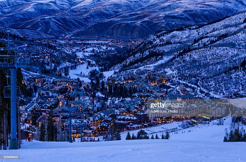 Beaver Creek Village at Dusk - Scenic view from ski slopes looking down with Avon, Colorado in background. Ski resort area with town lit up in evening dusk blue light. Beaver Creek, Colorado USA.