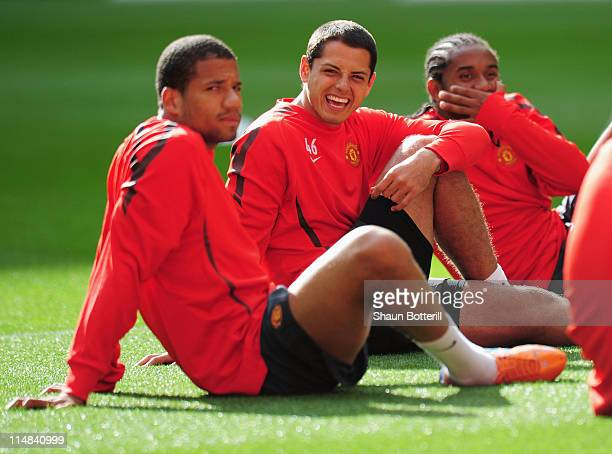 Bebe Javier Hernandez and Anderson of Manchester United sit down during a Manchester United training session prior to the UEFA Champions League final...