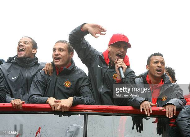 Bebe Nemanja Vidic Rio Ferdinand and Nani of Manchester United poses with the Barclays Premier League trophy during the Manchester United Premier...