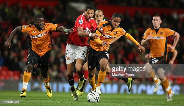 Bebe of Manchester United clashes with Michael Mancienne of Wolverhampton Wanderers during the Carling Cup Fourth Round match between Manchester...