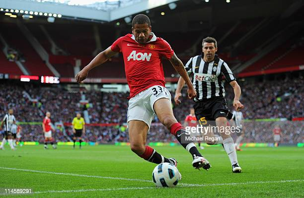 Bebe of Manchester United controls the ball as Andrea Barzagli of Juve looks on during the Gary Neville Testimonial Match between Manchester United...