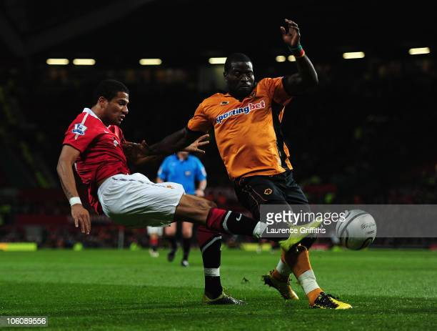 Bebe of Manchester United scores the opening goal under pressure from George Elokobi of Wolves during the Carling Cup fourth round match between...