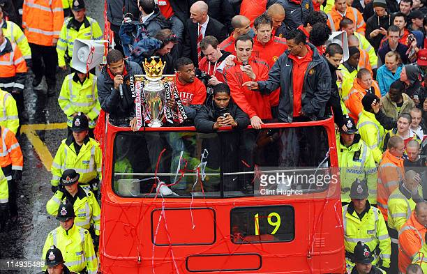 Bebe Patrice Evra Antonio Valencia Dimitar Berbatov and Nani of Manchester United celebrate with the trophy during the Manchester United Premier...
