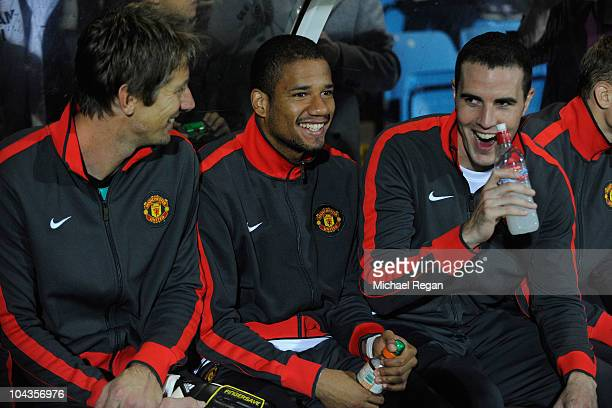 Bebe sits alongside Edwin van der Sar and John O'Shea on the bench during the Carling Cup 3rd Round match between Scunthorpe United and Manchester...