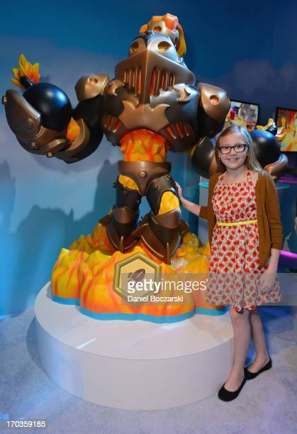 Bebe Wood plays the new Skylanders SWAP Force at Activision's E3 booth at Los Angeles Convention Center on June 11 2013 in Los Angeles California