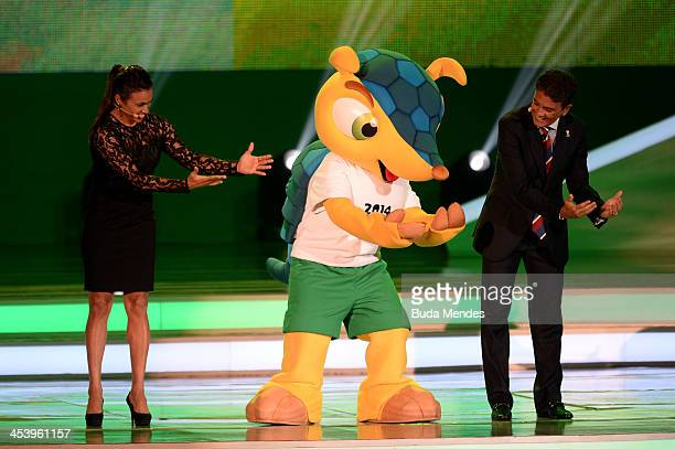 Bebeto performs his famous goal celebration with Marta and the official mascot Fuleco during the Final Draw for the 2014 FIFA World Cup Brazil at...