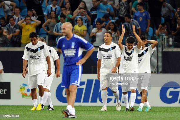 Bebeto player of Friends of Ronaldo celebrates a goal with his team mates during the 10th edition of Match Against Poverty between friends of Zidane...
