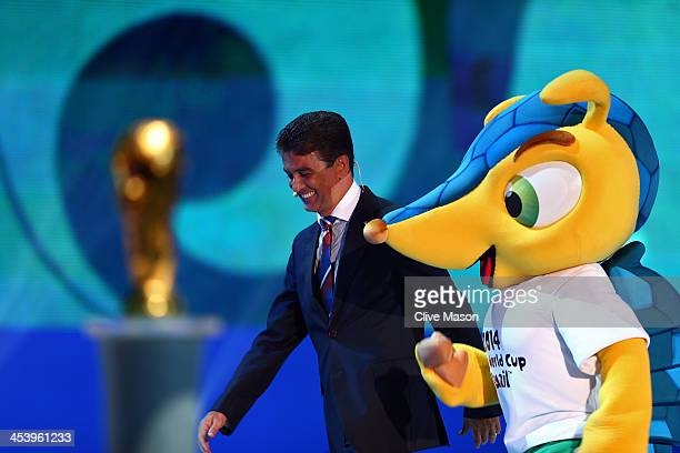 Bebeto walks on stage with the official mascot Fuleco during the Final Draw for the 2014 FIFA World Cup Brazil at Costa do Sauipe Resort on December...