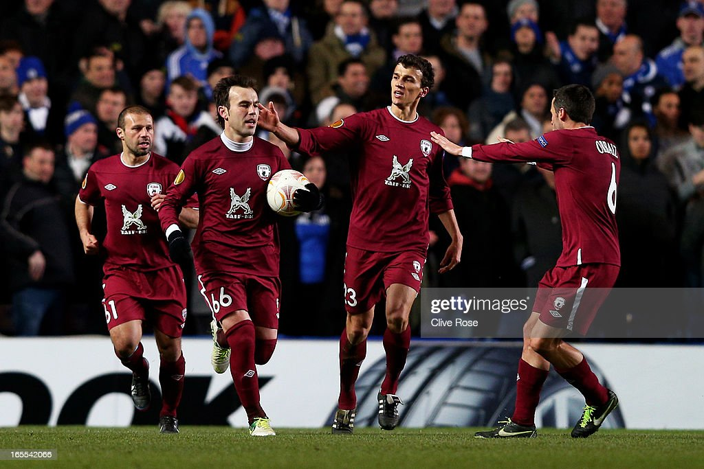 Bebras Natcho #66 of Rubin Kazan is congratulated by teammates after scoring a goal from the penalty spot during the UEFA Europa League quarter final first leg match between Chelsea and FC Rubin Kazan at Stamford Bridge on April 4, 2013 in London, England.