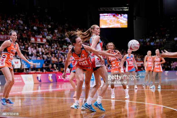 Bec Bulley of the Giants competes for the ball during the round seven Super Netball match between the Swifts and the Giants at Sydney Olympic Park...