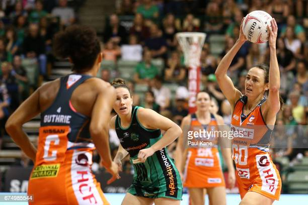 Bec Bulley of the Giants looks to pass the ball during the round 10 Super Netball match between the Fever and the Giants at HBF Stadium on April 30...