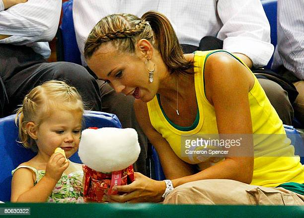 Bec Hewitt and her daughter Mia Hewitt watch the action during day one of the Davis Cup tie between Australia and Thailand at Townsville...