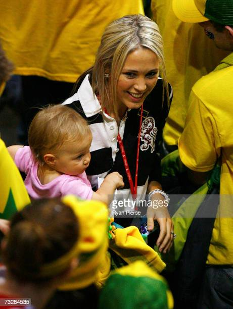 Bec Hewitt wife of Lleyton Hewitt of Australia and their daughter Mia Hewitt look on during day two of the Davis Cup World Group First Round tie...