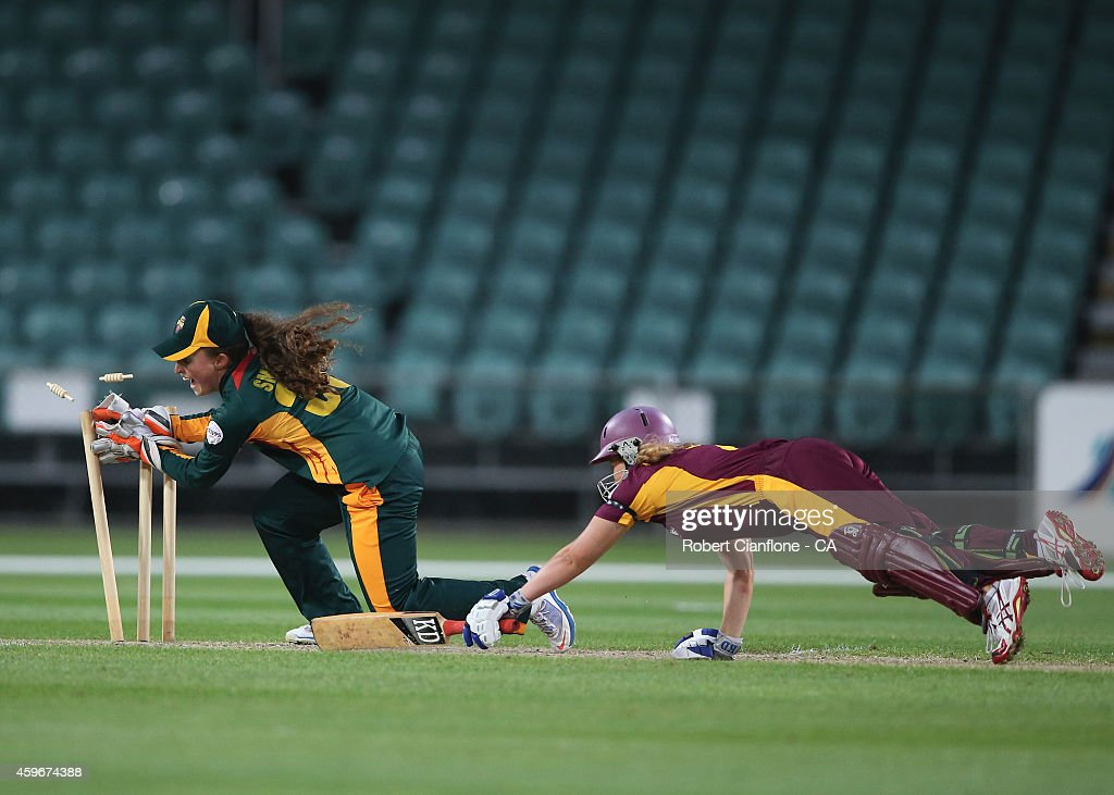 Bec Hollindale of the Queensland Fire is run out by Emily Smith of the Tasmania Roar during the WT20 match between Tasmania and Queensland Aurora...