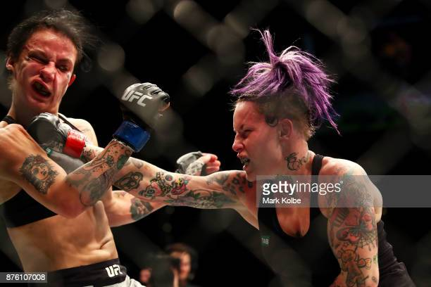 Bec Rawlings of Australia punches JessicaRose Clark of Australia in their women's flyweightbout during the UFC Fight Night at Qudos Bank Arena on...
